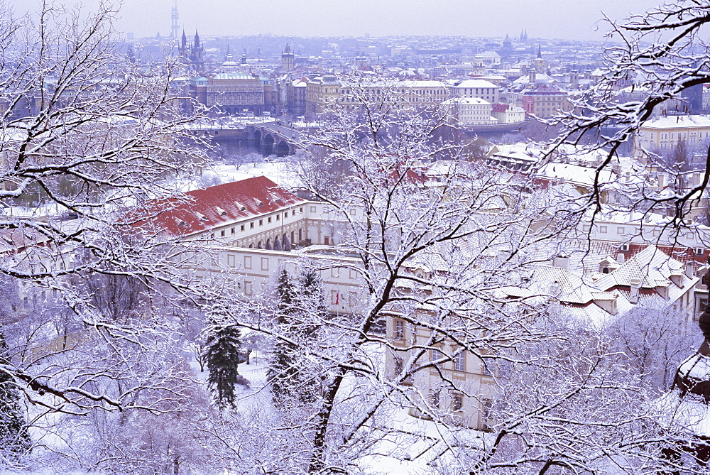 Snow covered Mala Strana and Stare Mesto rooftops, Prague, Czech Republic, Europe