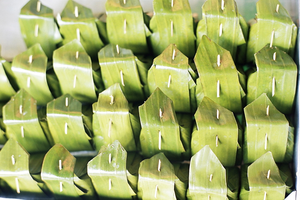 Food wrapped in banana leaf at open air market, Bangkok, Thailand, Southeast Asia, Asia