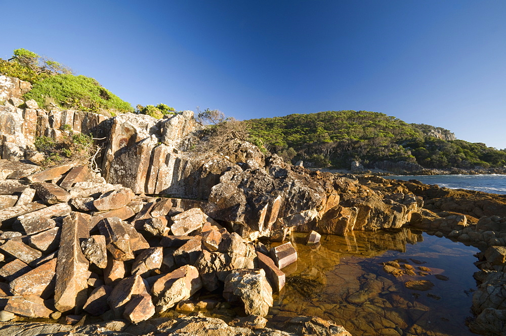 Mimosa rocks and rock pool in natural bay composed of volcanic Rhyolite rock, around 360 million years old, Mimosa Rocks National Park, New South Wales, Australia, Pacific