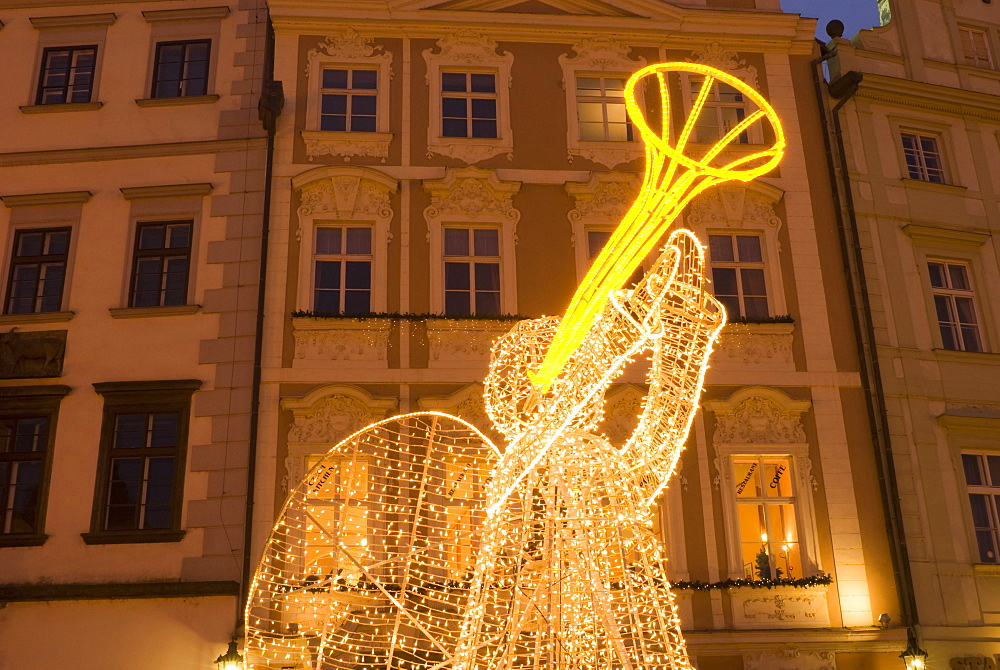 Illuminated angel against Baroque house facades, part of Christmas decorations, Staromestske (Old Town Square), Stare Mesto, Prague, Czech Republic, Europe