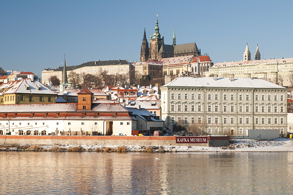 Snow-covered Prague Castle, Mala Strana and Vltava River, UNESCO World Heritage Site, Prague, Czech Republic, Europe