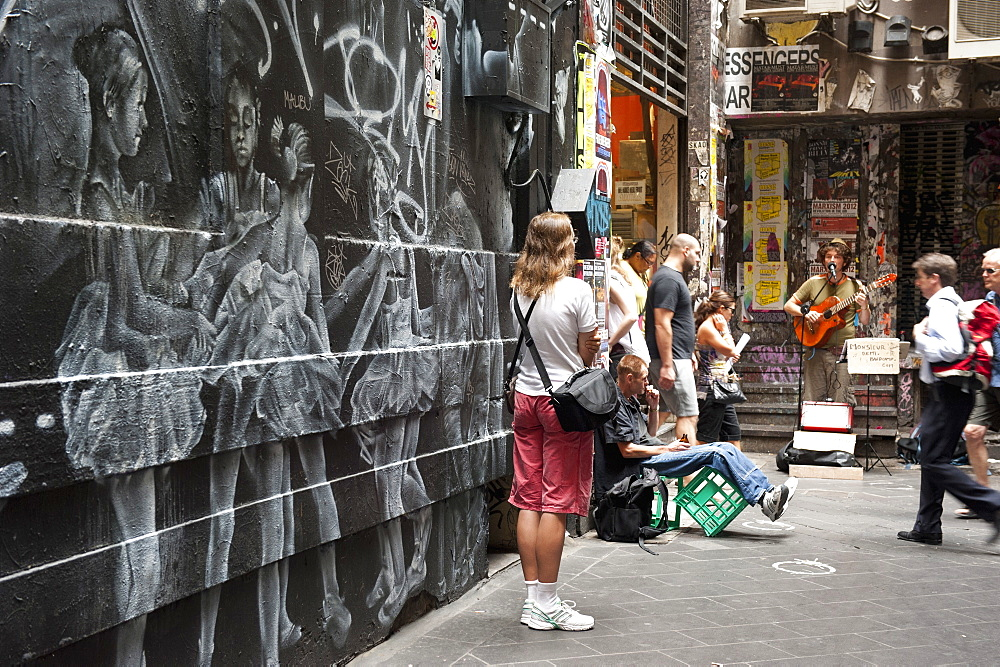 Graffiti and people watching street musician, Central Place, Melbourne, Victoria, Australia, Pacific - 737-619