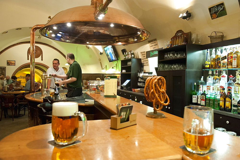 Barman pouring beer at bar of U Vejvodu Pub, Old Town, Prague, Czech Republic, Europe - 737-630
