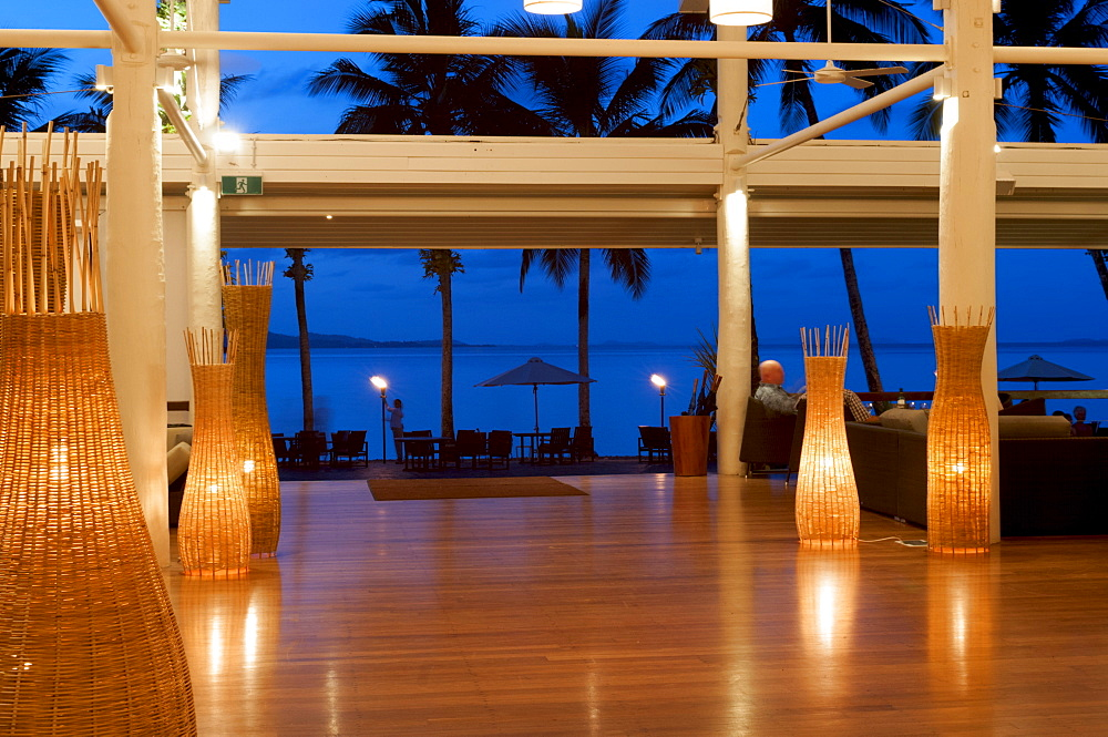 Looking out from lounge of Dunk Island Resort into Pacific Ocean, Great Barrier Reef, at twilight, Mission Beach, Queensland, Australia, Pacific - 737-655