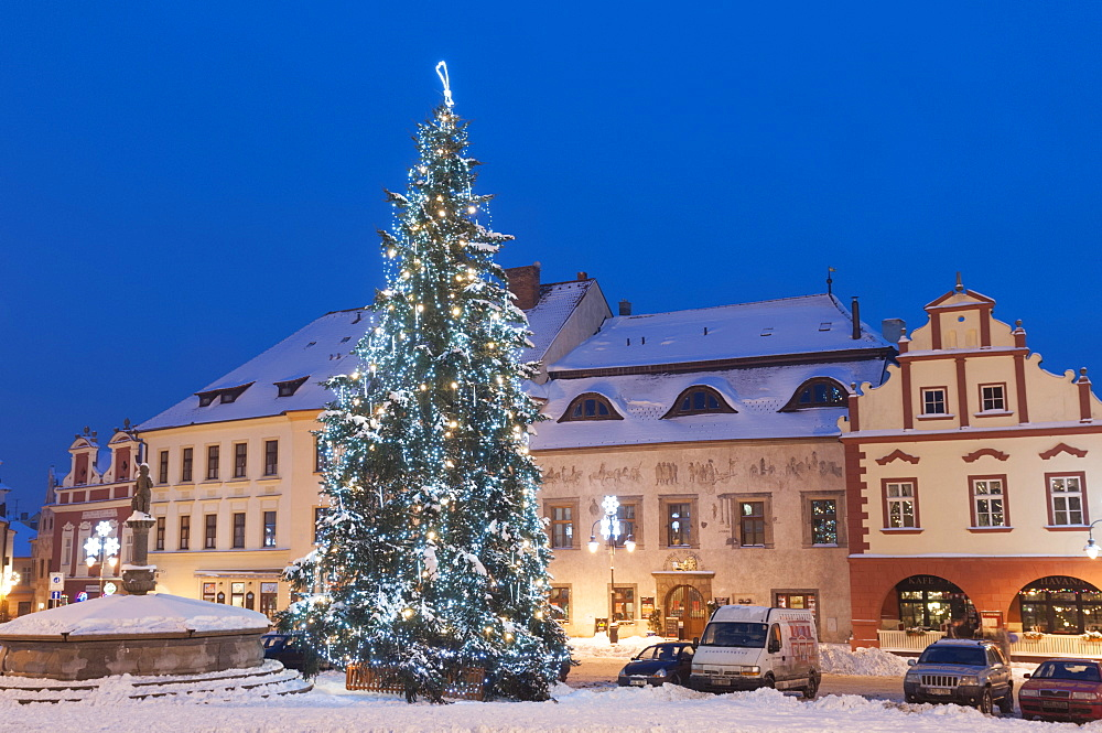 Snow-covered Christmas Tree and Renaissance buildings, Jihocesky, Czech Republic, Europe  - 737-675
