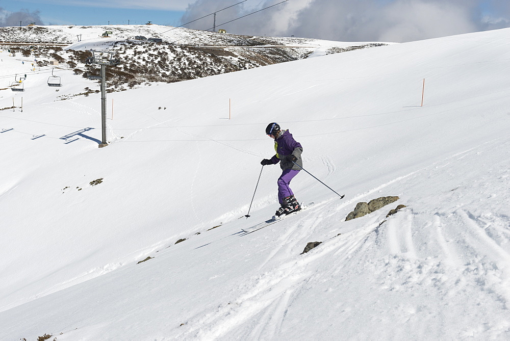 Young skier skiing The Chute, Mount Hotham, Victoria, Australia, Pacific