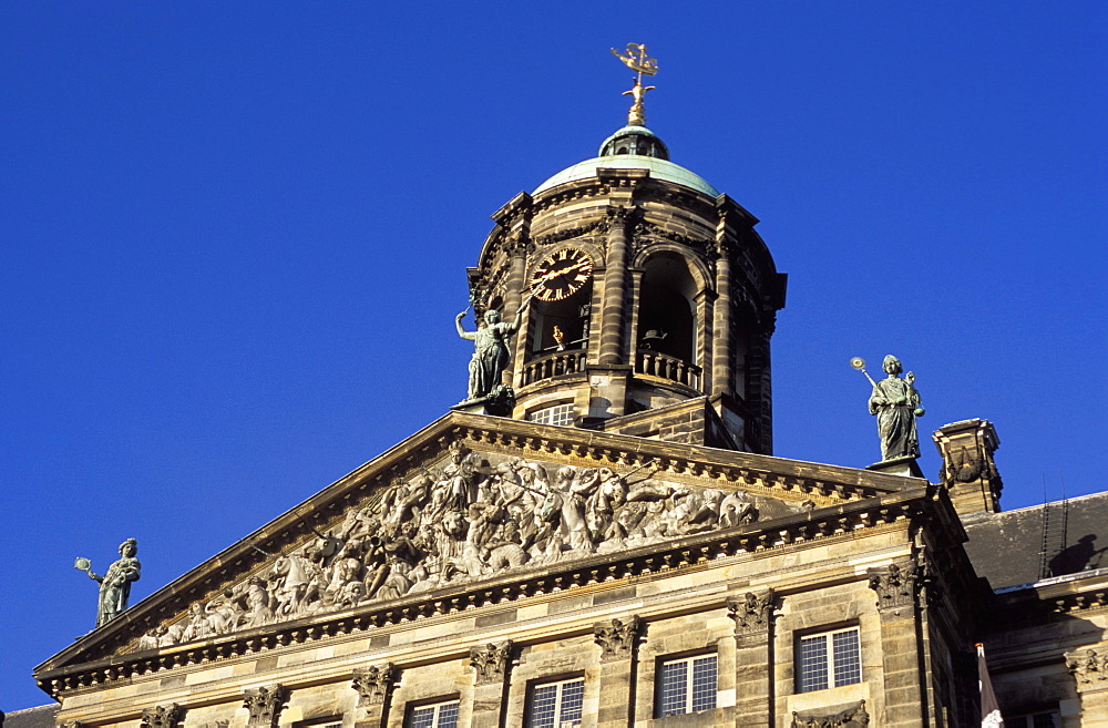 Detail of the decoration of the upper part and clock tower of the Royal Palace, Amsterdam, The Netherlands (Holland), Europe