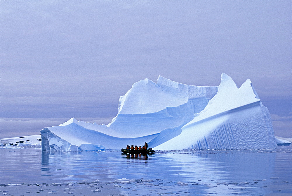 Tourists on Zodiac cruise around icebergs on the Antarctic Peninsula, Antarctica, Polar Regions
