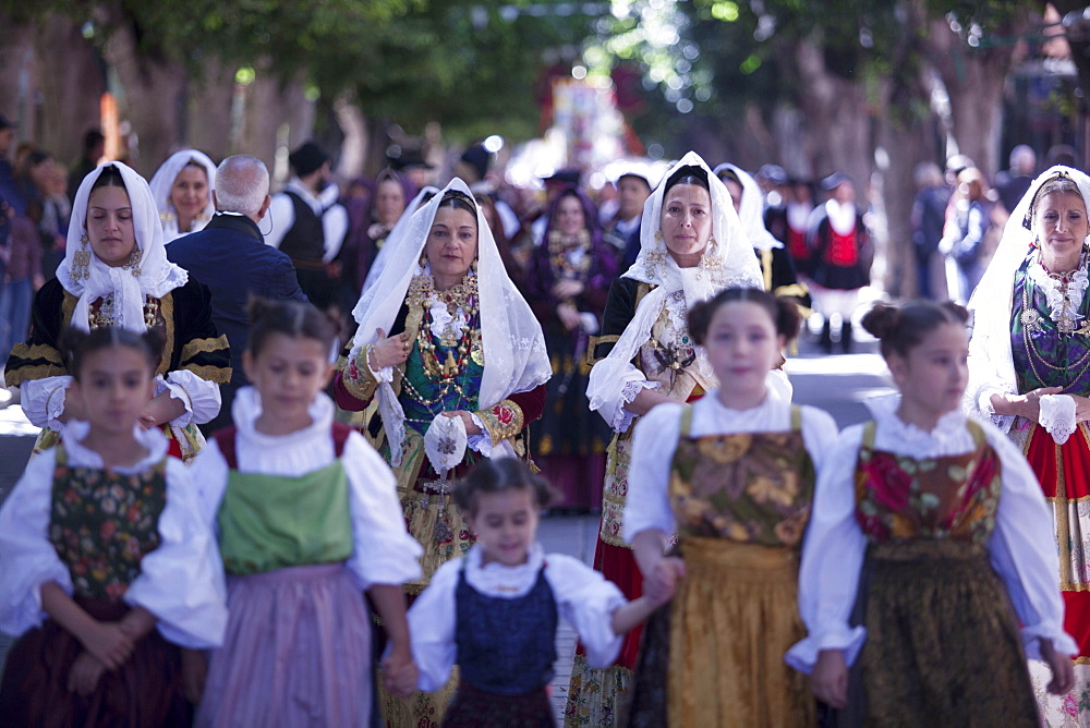Women and children in traditional dress during the Saint Antioco parade, Sant'Antioco, Sardinia, Italy, Europe
