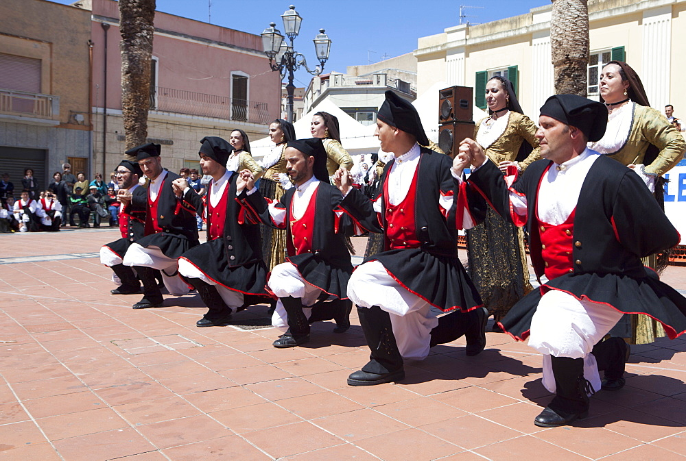 Men kneeling celebrating St. Antioco, patron saint of Sardinia, Sant'Antioco, Sardinia, Italy, Europe