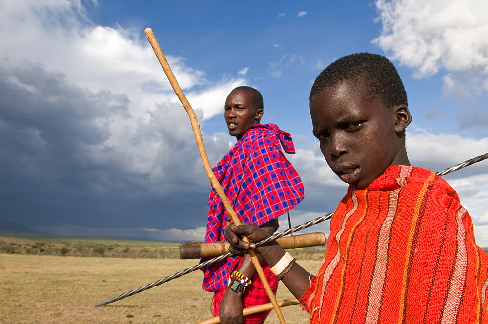Masai boy with his father, Masai Mara, Kenya, East Africa, Africa