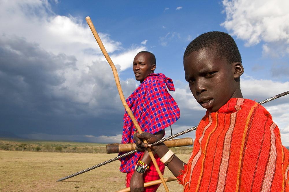 Masai boy with his father, Masai Mara, Kenya, East Africa, Africa - 741-3254
