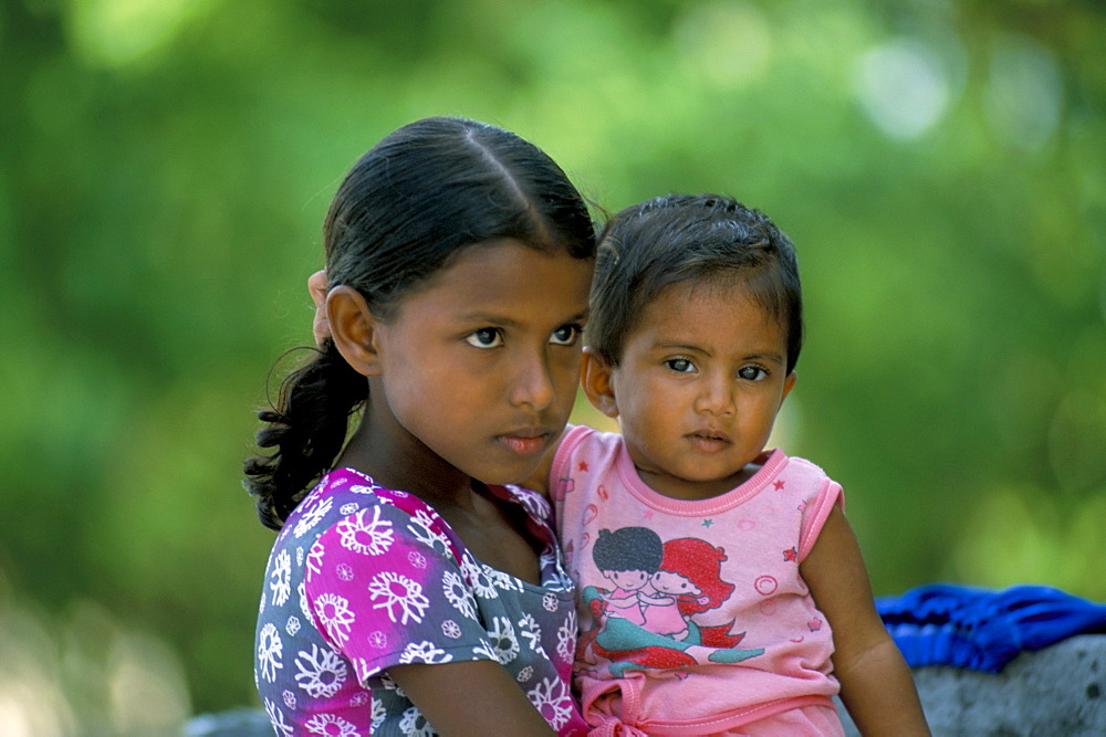 Portrait of two children, Dharavandu Island, Baa Atoll, Maldives, Asia