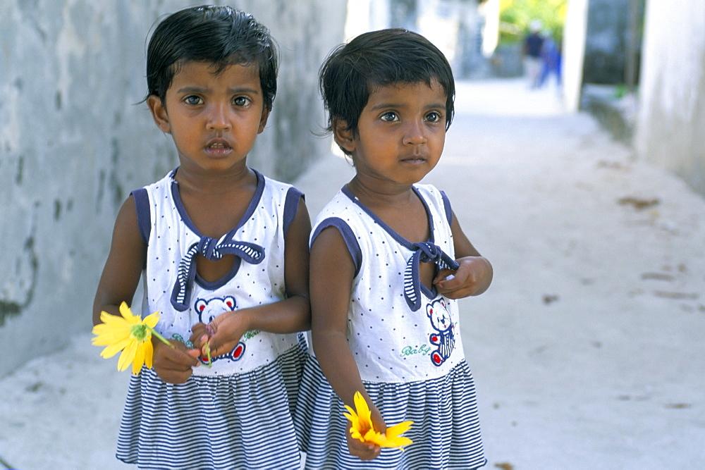 Portrrait of two little girls, Dharavandu Island, Baa Atoll, Maldives, Asia