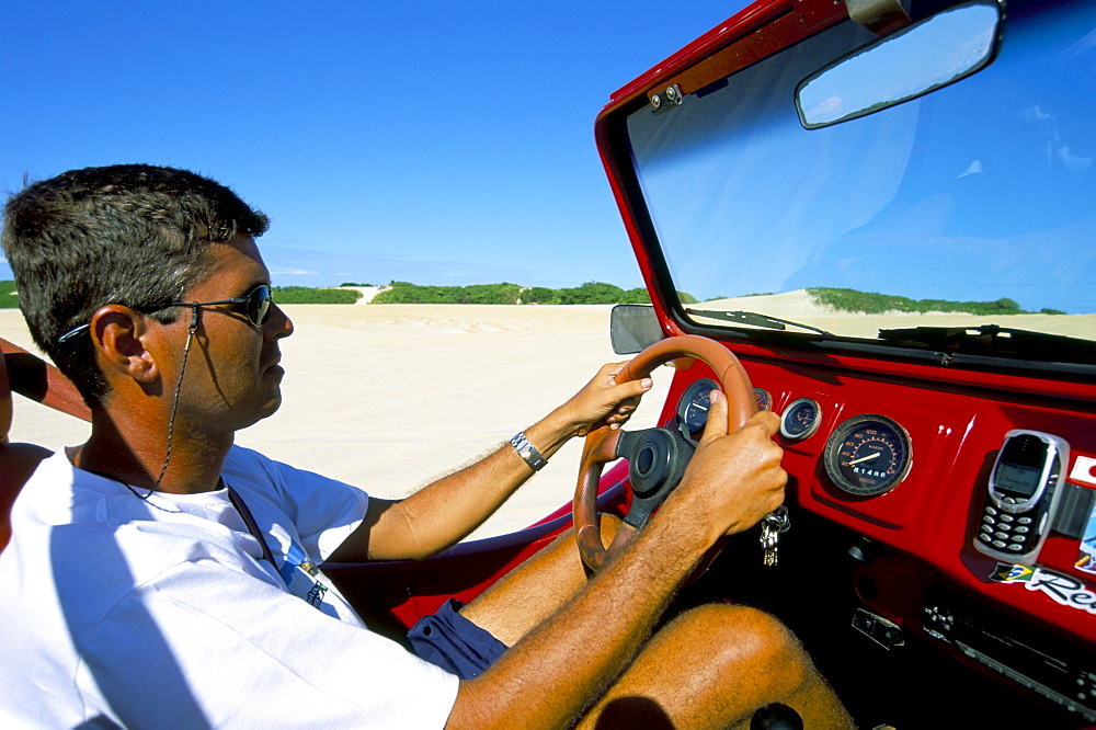 Driving dune buggy on sand dunes, Pitangui, Natal, Rio Grande do Norte state, Brazil, South America