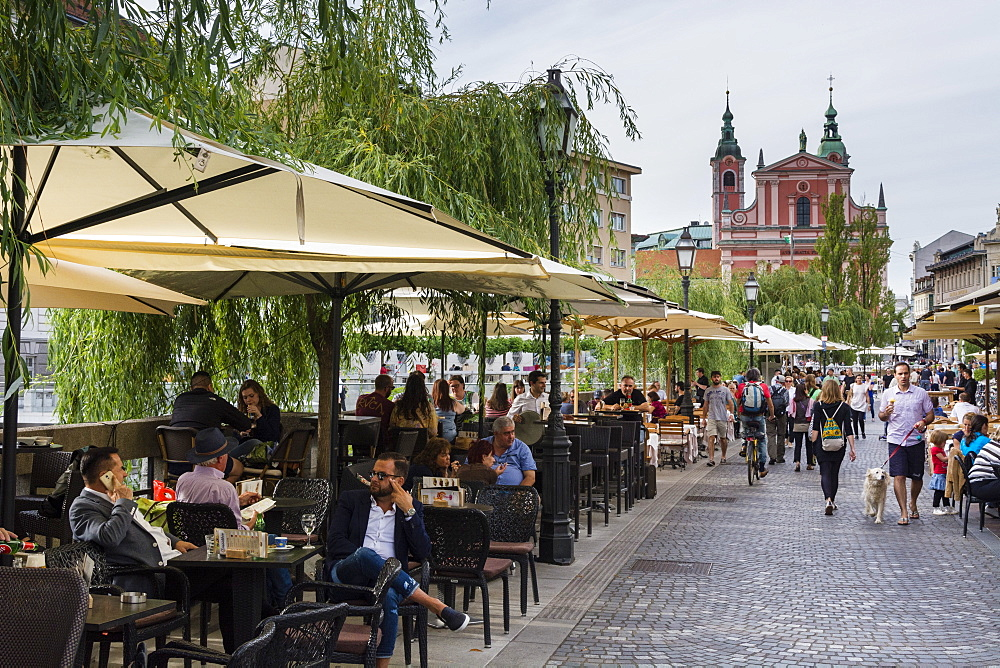 Outdoor cafes along the Ljubljanica river, Ljubljana, Slovenia.