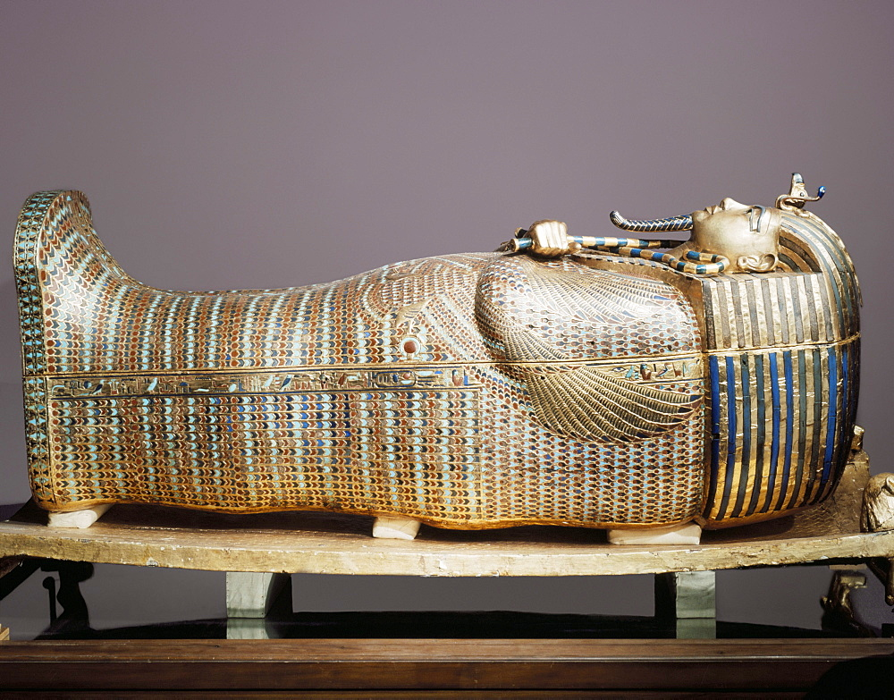 The second mummiform coffin made from gold-plated wood inlaid with glass-paste, from the tomb of the pharaoah Tutankhamun, discovered in the Valley of the Kings, Thebes, Egypt, North Africa, Africa