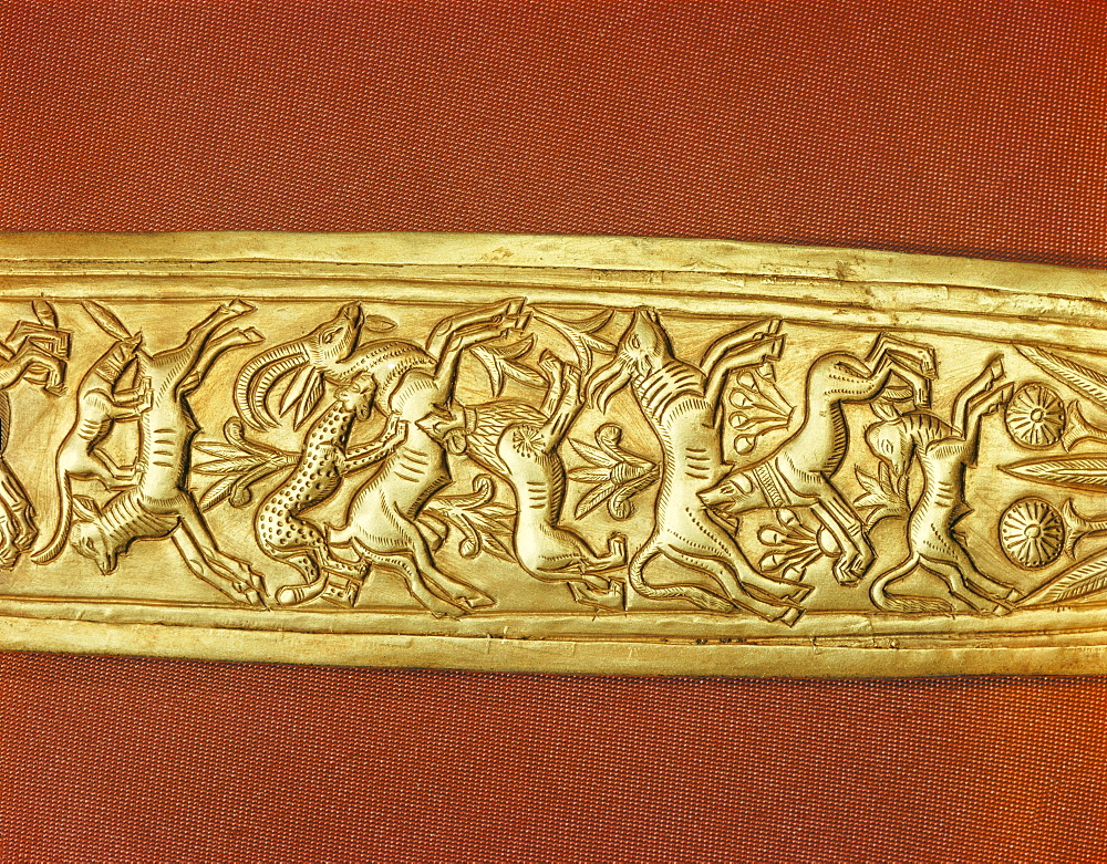 Detail of the gold sheath of one of the king's daggers showing animals in a hunting scene, from the tomb of the pharaoh Tutankhamun, discovered in the Valley of the Kings, Thebes, Egypt, North Africa, Africa