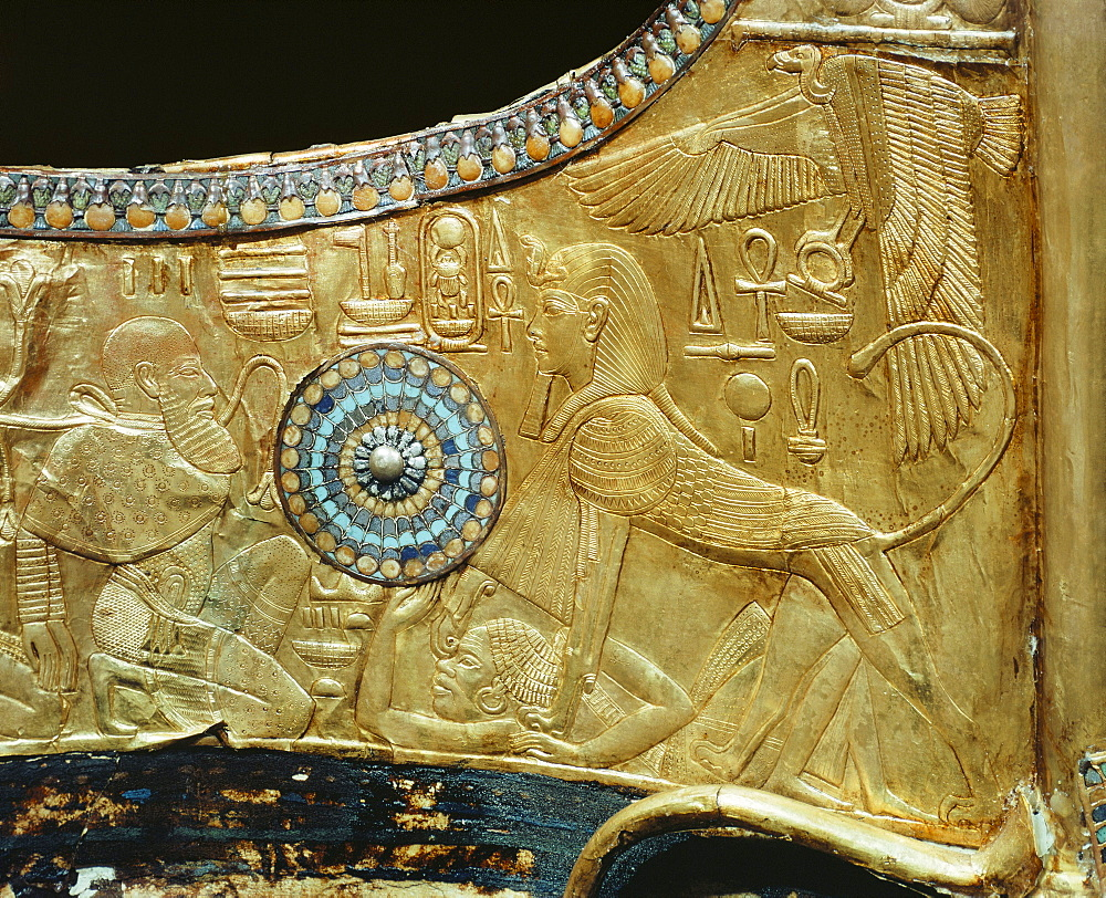 Detail from a state chariot showing the king as a sphinx trampling the enemies of Egypt underfoot, from the tomb of the pharaoh Tutankhamun, discovered in the Valley of the Kings, Thebes, Egypt, North Africa, Africa