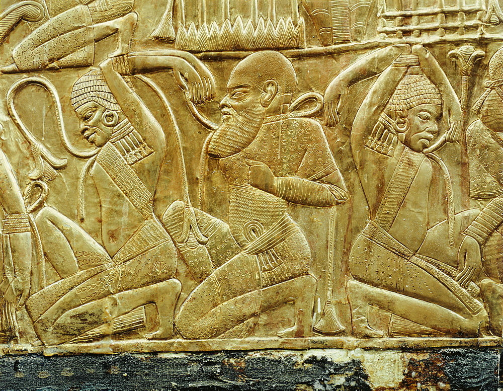 Detail from a state chariot showing the vanquished and enslaved enemies of Egypt, from the tomb of the pharaoh Tutankhamun, discovered in the Valley of the Kings, Thebes, Egypt, North Africa, Africa