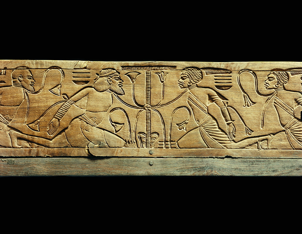 Detail from the ceremonial footstool of the king showing the enemies of Egypt conquered and beneath the yoke of the pharaoh, from the tomb of Tutankhamun, discovered in the Valley of the Kings, Thebes, Egypt, North Africa, Africa