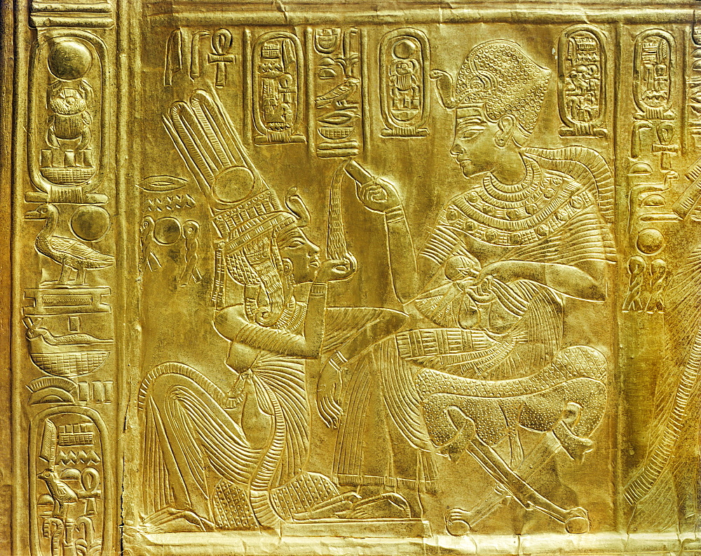 Detail of the exterior of the gilt shrine showing the king pouring perfumed liquid into the queen's hand, from the tomb of the pharaoh Tutankhamun, discovered in the Valley of the Kings, Thebes, Egypt, North Africa, Africa