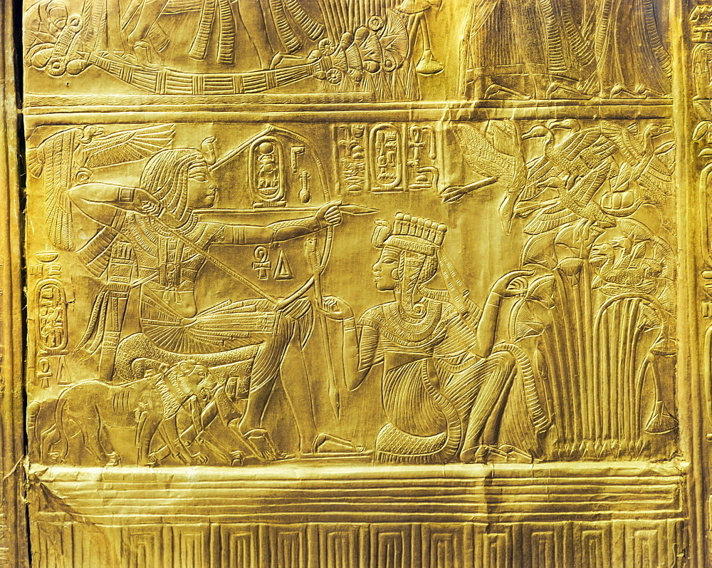 Detail of the exterior of the gilt shrine showing the queen helping the king in a ritual hunting scene, from the tomb of the pharaoh Tutankhamun, discovered in the Valley of the Kings, Thebes, Egypt, North Africa, Africa