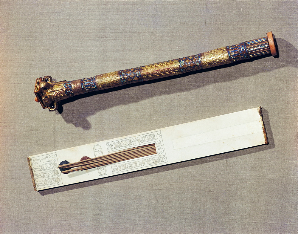 A scribe's palette in ivory and a case for writing-reeds made of wood plated with gold and inlaid with glass-paste, from the tomb of the pharaoh Tutankhamun, discovered in the Valley of the Kings, Thebes, Egypt, North Africa, Africa