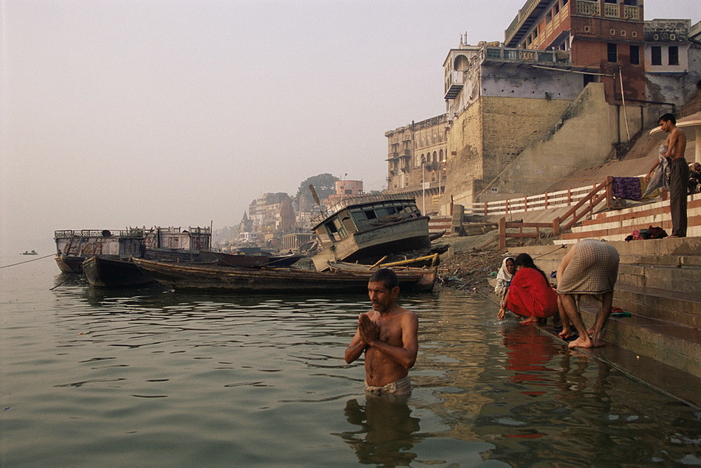 Morning ablutions, Hindu pilgrims bathing in the River Ganges (Ganga), Varanasi (Benares), Uttar Pradesh state, India, Asia