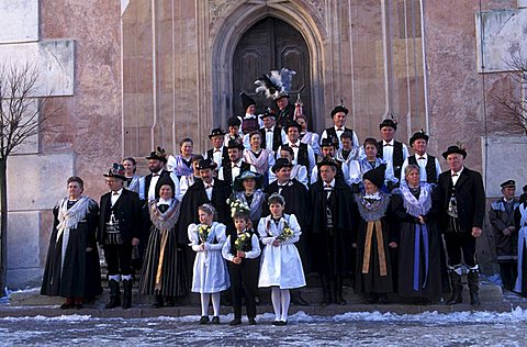 A peasant wedding, Guests posing in front of the church, Castelrotto, Trentino Alto Adige, Italy.