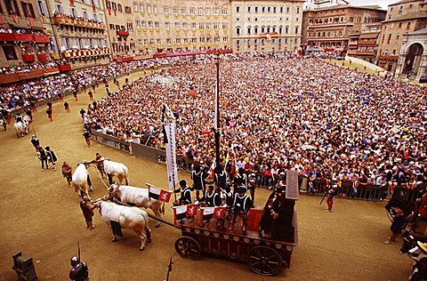 Piazza del Campo during the historical parade preceeding the Palio, Siena, Tuscany, Italy