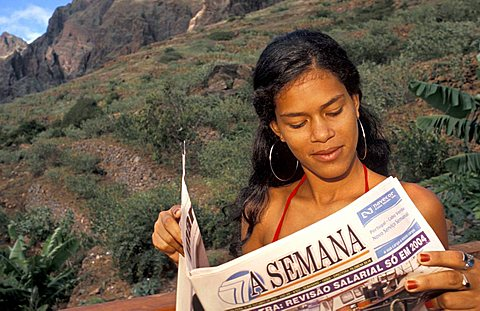 Girl reading a newspaper, Cape Verde Islands, Africa