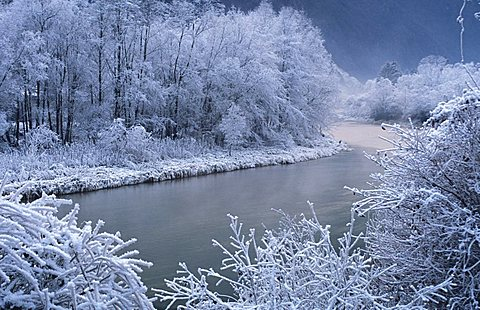 Alpine river with snow, Valsugana, Trentino Alto Adige, Italy