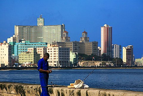 Fishing on Malecon promenade, Havana, Cuba, West Indies, Central America