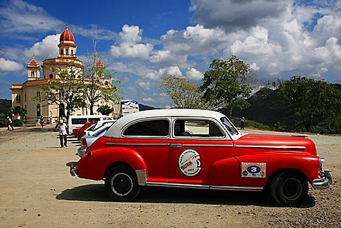 Vintage car in front of Virgen de la Caridad del Cobre sanctuary, Santiago de Cuba, Cuba, West Indies, Central America