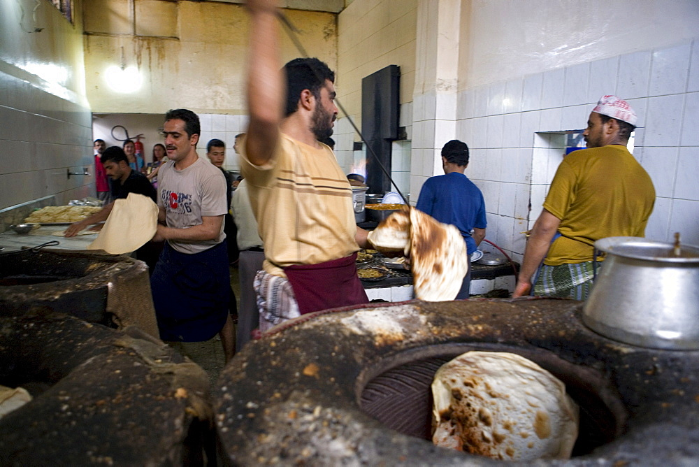 Preparation of typical arab bread, Yemenite restaurant, Sana'a, Yemen, Middle East