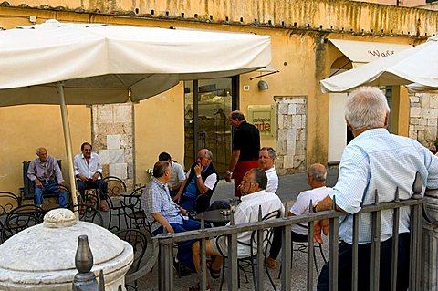 People relaxing, Piazza del Duomo, Pietrasanta, Tuscany, Italy
