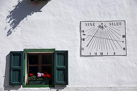 Foreshortening of a house with window and sundial, Mezzocorona, Trentino, Italy