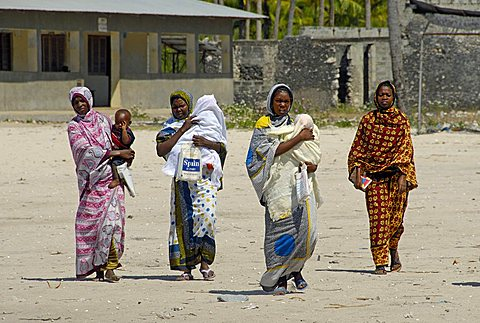 Woman with children through the fishing village, Zanzibar, United Republic of Tanzania, Africa