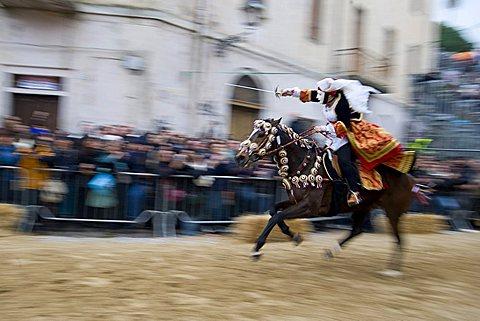 amazone Horseman gallops to pierce the star with his sword, Sartiglia feast, Oristano, Sardinia, Italy, Europe
