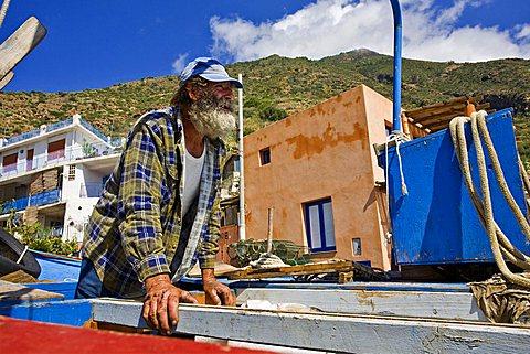 Boat mechanic, Salina Isaland, Messina, Sicily, Italy, Europe
