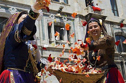 Women in traditional dress, ramadura, Sant'Efisio traditional religious feast,  Cagliari, Sardinia, Italy