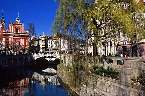 The Cathedral and Plecnik Three Bridges on Ljubljanica river, City center, Ljubljana, Slovenia, Europe