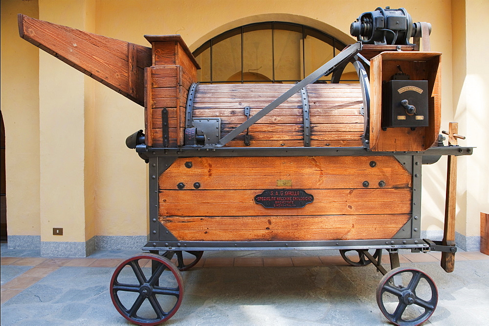"""Contratto wine producer in Canelli, an ancient multipurpose machine for pressing wine named """"pigia-deraspatrice"""", Asti, Piedmont, Italy"""
