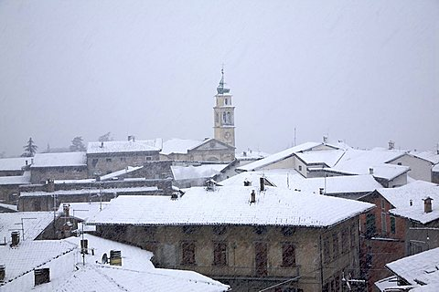Ala village city during snowfall, Vallagarina, Trentino