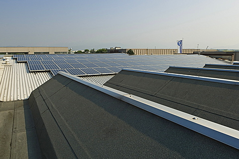 solar power system on factory, azzano san paolo, italy