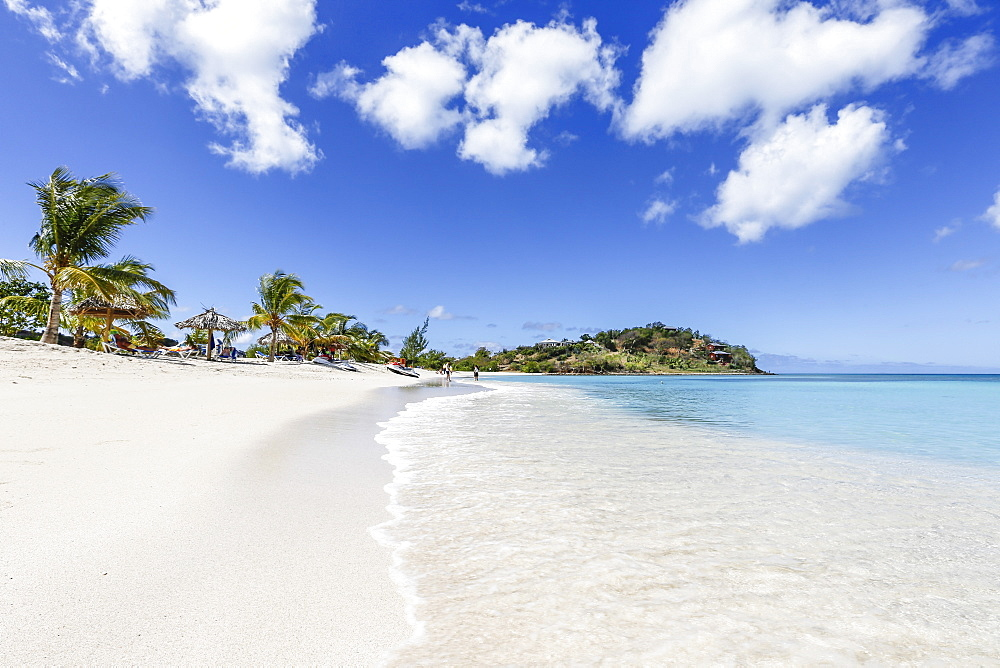 Palm trees and white sand surround the turquoise Caribbean Sea, Ffryers Beach, Antigua and Barbuda, Leeward Islands, West Indies