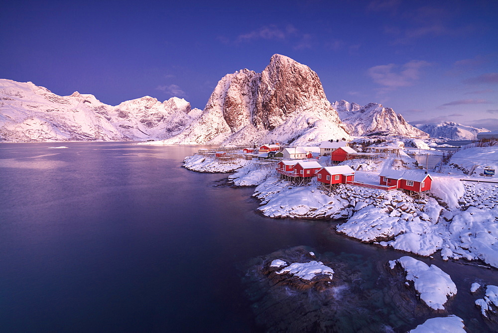 The colors of dawn on snowy peaks and the frozen sea around the fishing village Hamnoy Nordland, Lofoten Islands, Norway, Europe - 746-87767