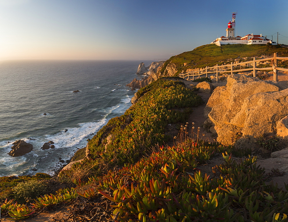 Panoramic view of the cape and lighthouse of Cabo da Roca overlooking the Atlantic Ocean at sunset, Sintra, Portugal, Europe