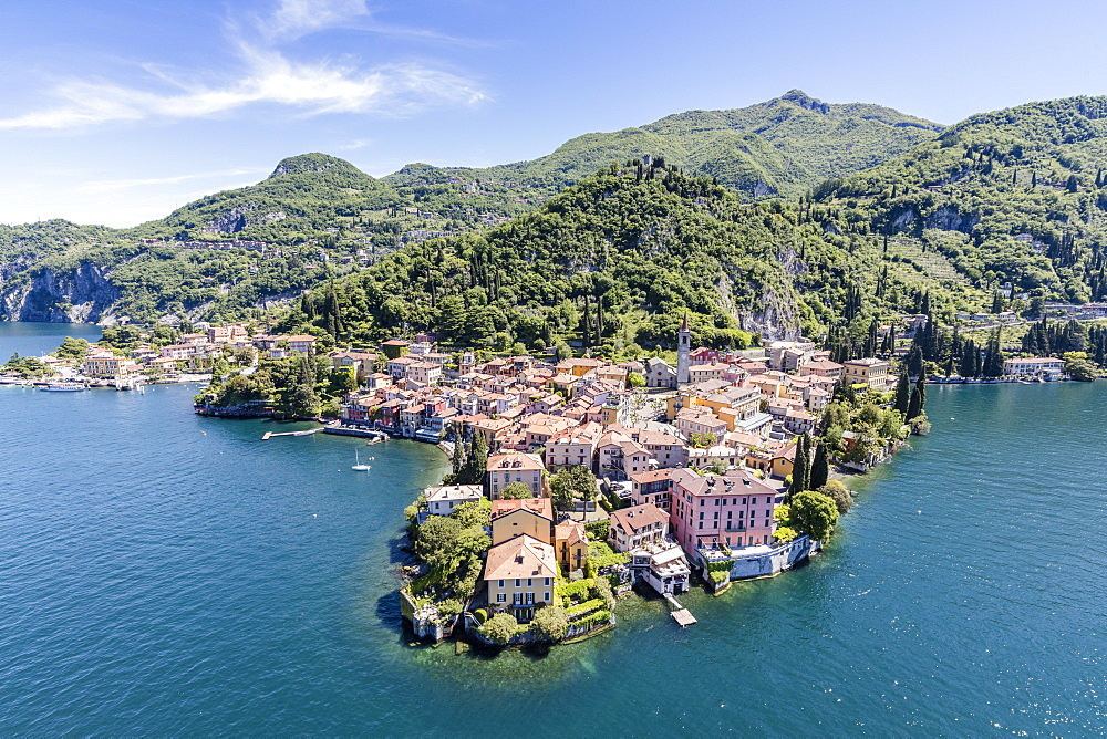 Aerial view of Varenna frames by the blue water of Lake Como on a sunny spring day, Lombardy, Italy, Europe